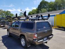Thule Tracker II rack with 2 Thule Hullavator pro Kayak lift assist system
